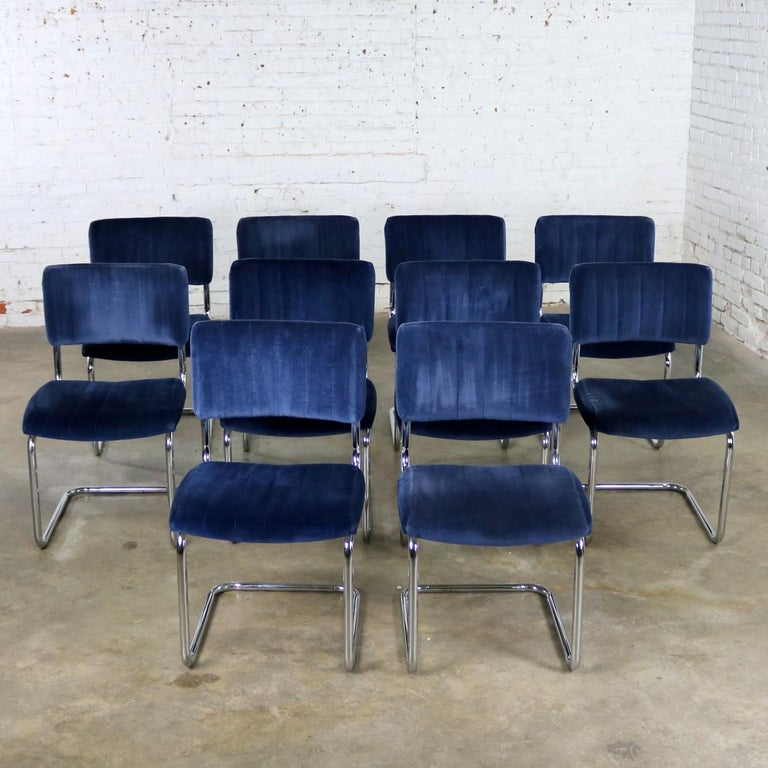Wonderful set of ten cantilevered chrome and light blue velvet dining chairs after the Cesca chair designed by Marcel Breuer in 1928. This set is made by Segars Tubular Products and all ten of the chairs are in wonderful vintage condition with