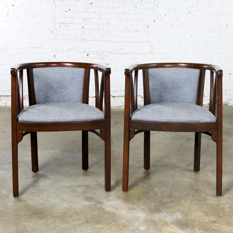 Handsome pair of Bauhaus or Art Deco style bistro side chairs with level back and arms by Loewenstein-Oggo. They are in wonderful vintage condition. The blue-gray fabric is in excellent shape. The wood frame is in great shape but does have a few