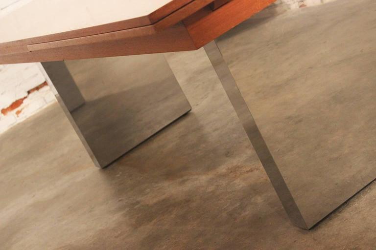 Mid century modern teak and stainless steel extending table at 1stdibs