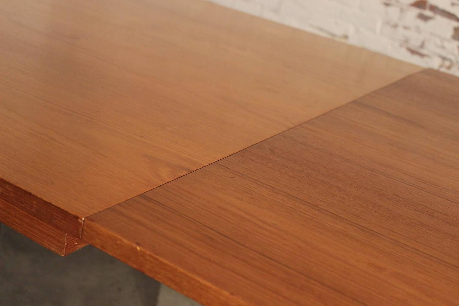 Mid century modern teak and stainless steel extending table for sale