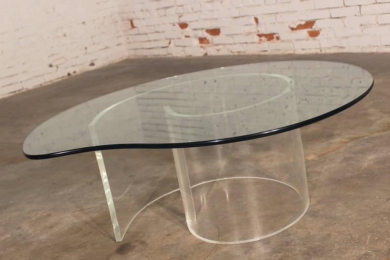 Hollywood Regency at its finest in this vintage pair of Mid-Century Modern Lucite, glassed topped