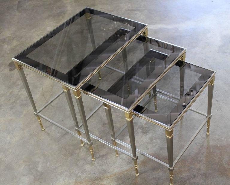 Brass and stainless nesting tables with mirror edged glass for Glass top nesting tables