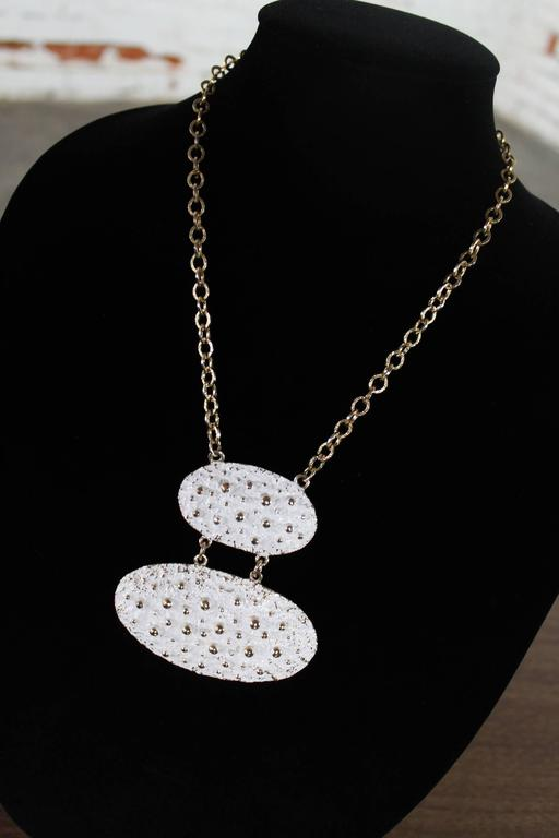 Gorgeous vintage white enamel and gold-tone Napier necklace in a chunky Brutalist, 1970s mod styling. Attributed to Francis Fujio this huge pendant necklace will make a statement whatever the outfit you wear it with.  Oh my goodness this is such a