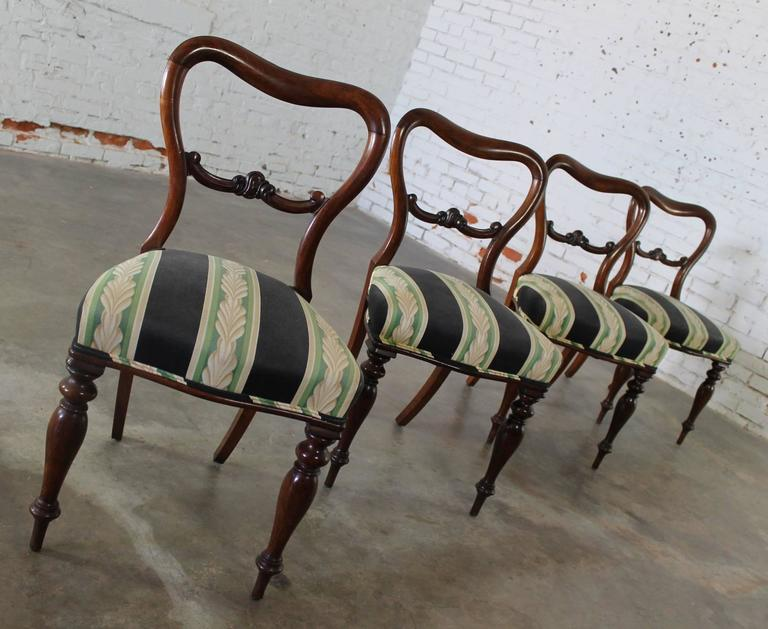 Set of four stately and elegant antique Victorian rosewood dining chairs in the manner of Gillows. They are all in wonderful condition, recently upholstered and ready to use.  Beautiful set of four antique Victorian rosewood dining chairs in the