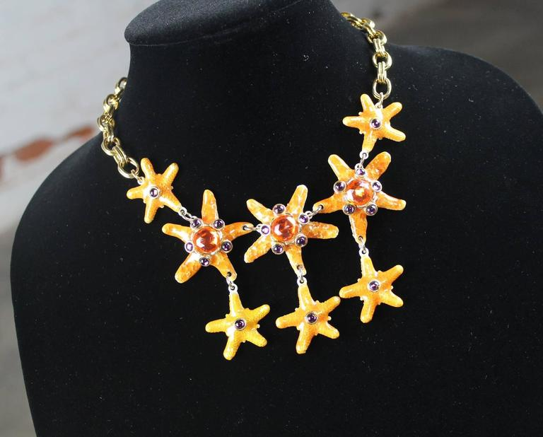 Absolutely stunning bib necklace by Gem-Craft Corp and signed Craft © consisting of eight bejeweled starfish on a chain. It is in very good vintage condition with no missing jewels.  This vintage bib style necklace consisting of eight wonderful