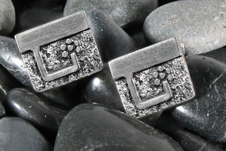 Handsome pair of circa 1970 Guy Gilles Vidal cufflinks, Brutalist style in silver plated pewter. Signed and in good vintage condition.  What a handsome pair of cufflinks by Canadian Montreal-based jewelry maker Guy Gilles Vidal. These wonderful
