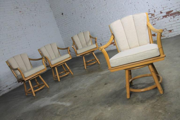 American Mid-Century Ficks Reed Co. Round Rattan Game Table with Four Swivel Armchairs For Sale