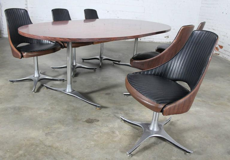 20th Century Mid-Century Dinette Set, Oval Double Pedestal Table with Six Swivel Chairs For Sale
