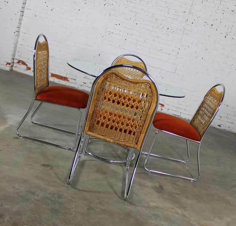 Mid-Century Daystrom round glass and chrome dinette table and four chrome and wicker chairs Fabulous vintage Mid-Century Modern dinette set by Daystrom Furniture featuring a round glass top chrome base table and four chairs with arched top chrome
