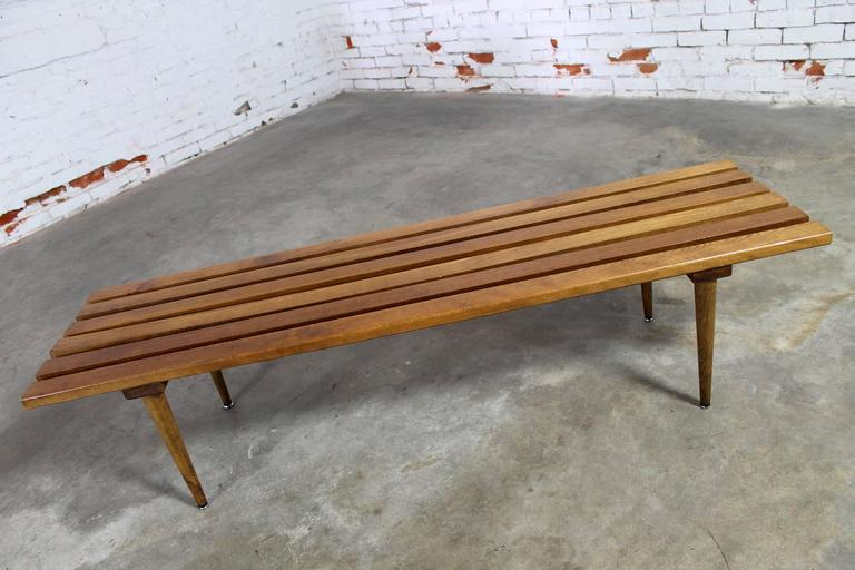 Iconic Mid-Century Modern slatted bench or coffee table from Yugoslavia. In wonderful vintage condition with the normal nicks and dings of use but nothing major. There is also a small red possibly ink mark, circa 1960s.
