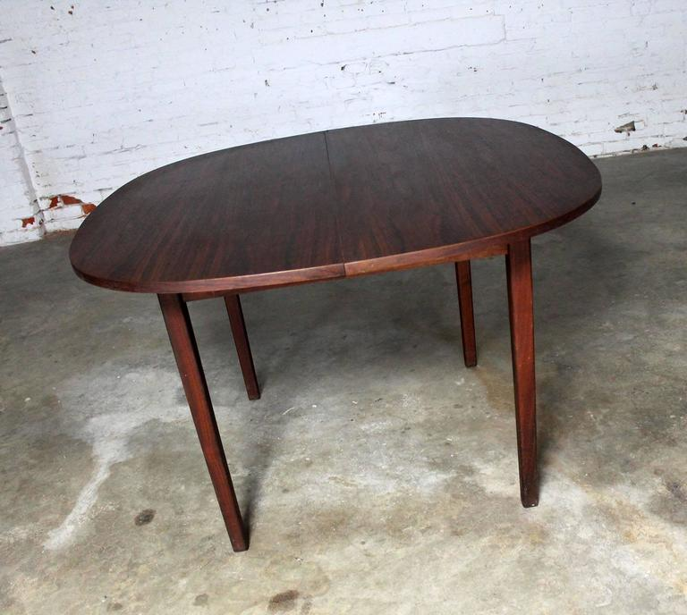 rosewood squircle to oval shaped expanding dining table