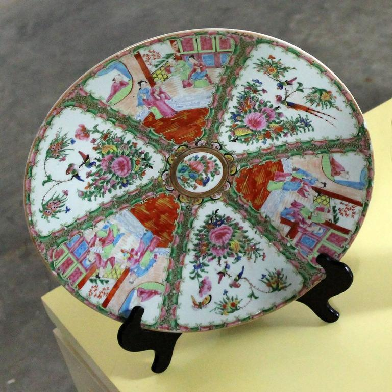 Gorgeous and wonderful large antique Chinese Rose Medallion charger, platter, or chop plate with traditional medallion design with village scenes and floral panels. Qing Dynasty, circa 1850-1890 and in fabulous antique condition. It does have at