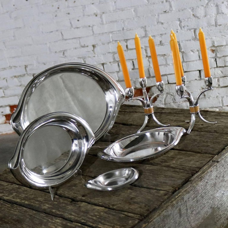 Gorgeous set of six pieces of silver-plate by 1847 Rogers Bros. IS from their Flair line. The set includes one large serving tray, a pair of smaller serving trays, a bon bon dish, and a pair of candelabra. They are all in wonderful condition apart