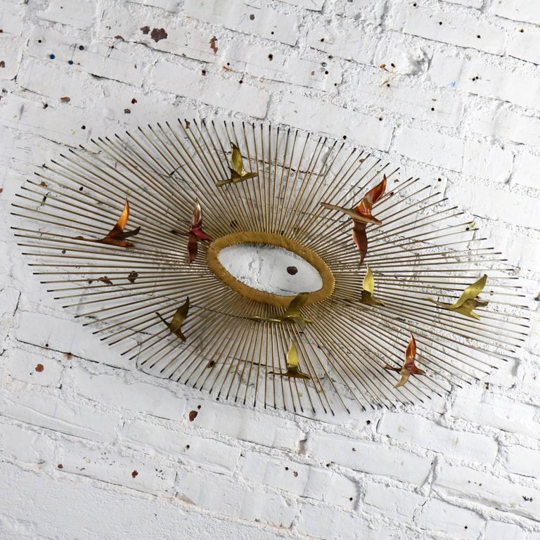 Handsome steel, copper and brass Mid-Century Modern wall sculpture depicting an oval sunburst with birds attributed to C. Jere; however, this one is unsigned. In wonderful vintage condition with no outstanding flaws, circa 1960s-1980s.  Not a