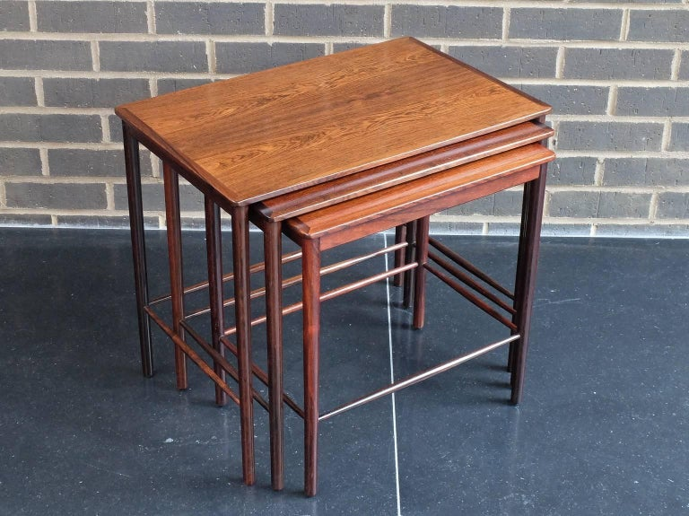 A nest of three occasional tables designed by revered designer Kai Winding and manufactured by Poul Jeppesen, Denmark, circa 1960. These elegant tables are beautifully crafted from Brazilian rosewood. Please note that there are differences in colour