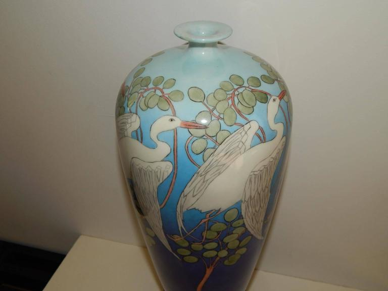 American Belleek, early 20th century. Art Deco/Art Nouveau/Arts & Crafts. Gorgeous blue vase decorated with snowy egrets. Marked on the bottom with the entwined snake Belleek Willets mark. And signed on the bottom F.M. Mulligan, 1908. Measures:
