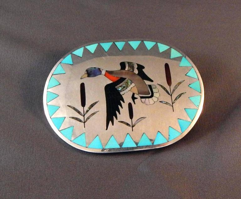 This beautiful Native American made sterling buckle is inlaid with