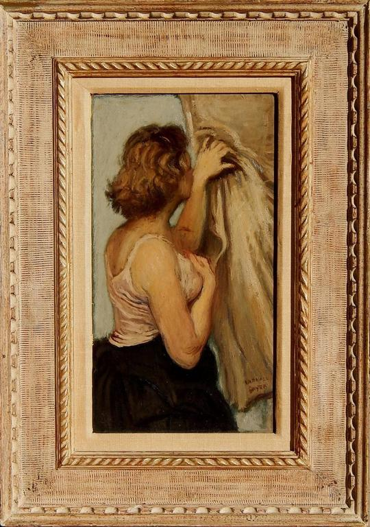 This is a beautiful oil painting by social realist Raphael Soyer (1899-1987) It is in excellent condition and has a remnant of an Associated American Artists label on the verso. It measures 16 x 9 inches image size. Frame size is: 24 x 17