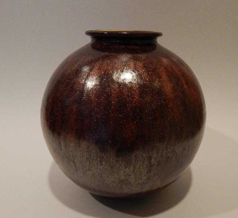 James Lovera (1920-2015) ceramic studio vase. This beautiful vase by James Lovera has a wonderful and unusual copper colored glaze and dates to the 1960s, perhaps as early as the 1950s. In excellent condition and signed on the underside: