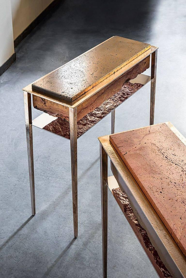 Each of these unique tables by acclaimed artist and master-craftsman, Gianluca Pacchioni, is handcrafted at the sculptor's studio in Milan. Liquid brass is poured onto raw slabs of red Persian travertine and suspended mid-air by uncannily thin legs.