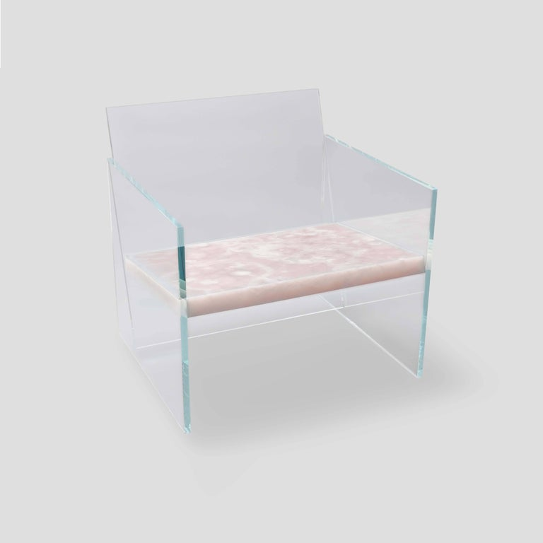 Characterized by its material and form, this lounge chair is made of ultra-clear glass and rose onyx; it is one of seven works from the Tension collection. Claste drew inspiration from the juxtaposition of stability and fragility to create this