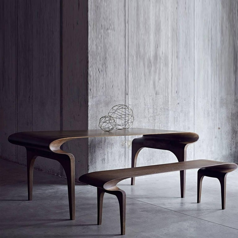 Handmade in a British workshop using the finest natural finishes, the Contour furniture series is an intuitive extension of Bodo Sperlein's sculptural tableware.  The impeccable, fluid curves of the solid wood tables and benches reflect the