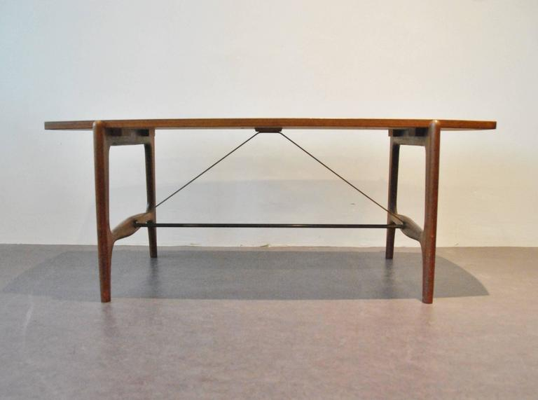 danish coffee table with organic teak frame veneered top and brass