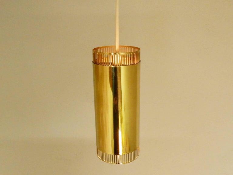Set Of Three Pendant Lights In Brass Scandiavian 1960s