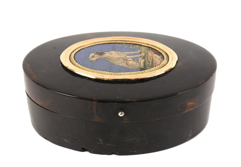 Italian micro mosaic plaque mounted within snuff box, depicting white and brown hound seated on grass. Circle of Giacomo Raffaelli (1753-1836).  Rome, Italy, circa 1800s. Mosaic measures 2 in.