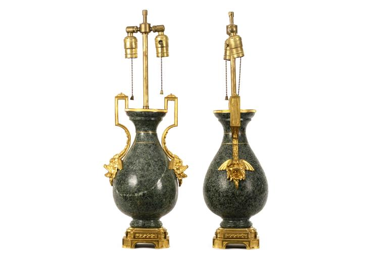 Pair of French vases with ormolu mounts on granite, now mounted as lamps.