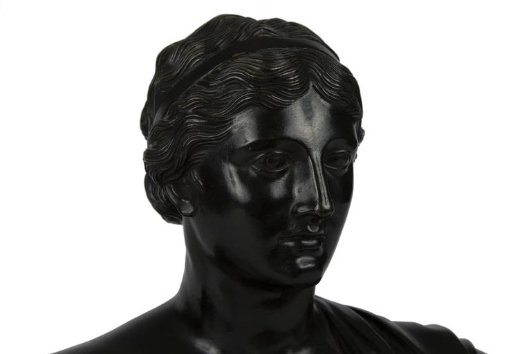 Italian patinated bronze bust of a classical woman. Mounted on giallo di siena and nero di belgio base, Grand Tour, 19th century.