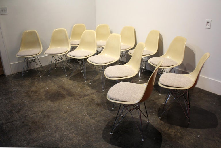 Set of 12 vintage Eames for Herman Miller fiberglass side chairs, circa 1960. Newly reupholstered in elegant textured and blended weave of gray, tan, brown and gold. Steel