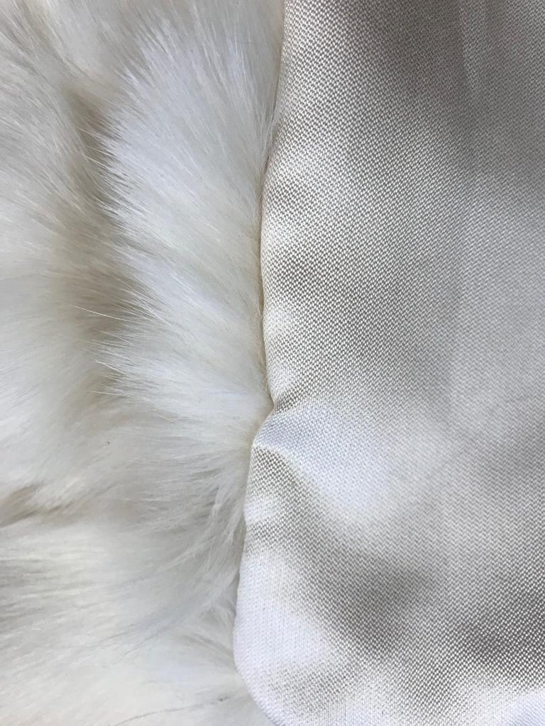 Pair of white fox pillows with Italian silk backing.