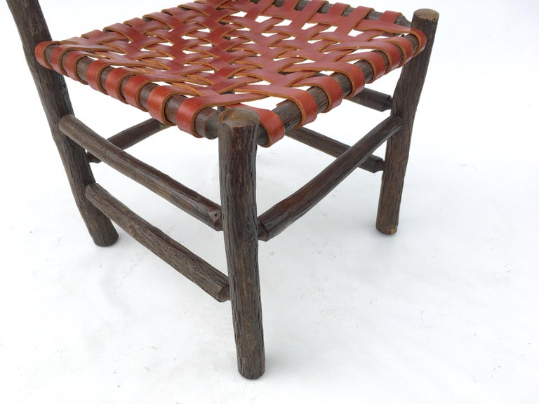 American Twelve Old Hickory Dining Chairs with Woven Cognac Saddle Leather For Sale