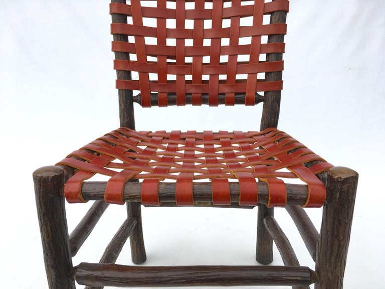 Twelve Old Hickory Dining Chairs with Woven Cognac Saddle Leather In Good Condition For Sale In Miami, FL