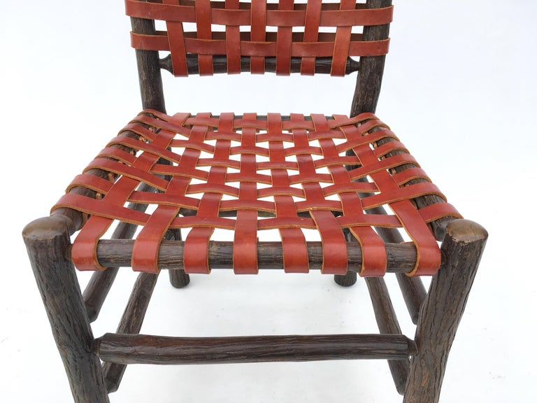 Twelve Old Hickory Dining Chairs with Woven Cognac Saddle Leather For Sale 1