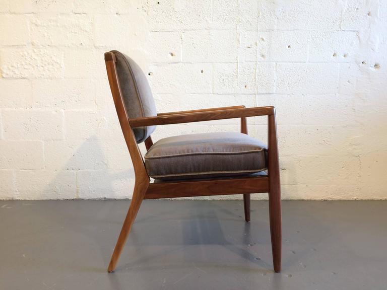 Pair of modern walnut armchairs, USA, 1950s. Solid walnut armchairs.