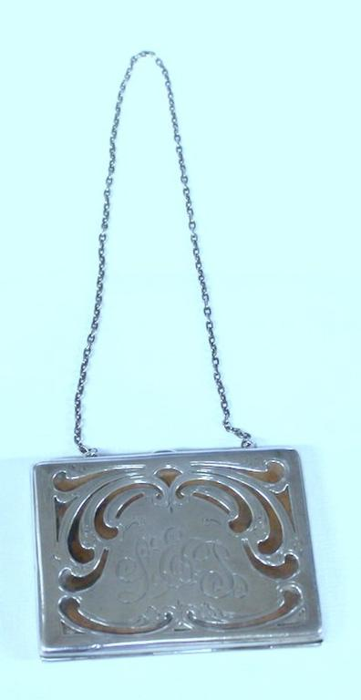 Superb old American hand pierced and engraved sterling card case or coin purse with chatelainechain. Please note superbly pierced, engraved and monogrammed purse with original calfskin leather interior.