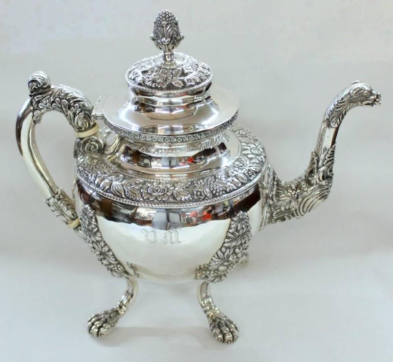 Rare and important antique American extraordinarily heavyweight coin silver (.900 Fine) Rococo style four-piece tea set including exceptional teapot, two handled covered sugar bowl, cream jug and waste bowl.  Maker: Andrew de Milt, New