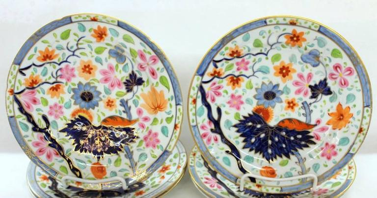 Set of four exceptional antique English hand-painted porcelain luncheon/dessert plates in the banana leaf pattern with superbly hand-painted flowers and leaves overall.  Attributed to Coalport (One plate very lightly crazed).
