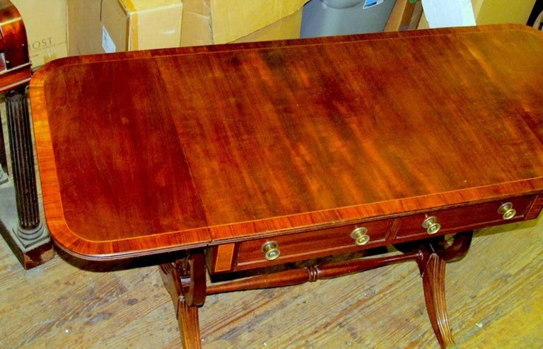 Fine and rare antique English George IV period inlaid mahogany Regency drop-leaf sofa table, with handsome