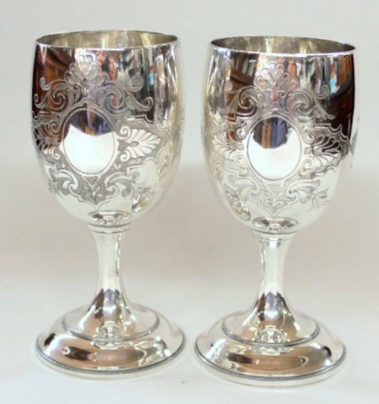 Rare pair of antique American silver plate hand chased and engraved goblets. Please note the fabulous hand engraved motif of the church to the obverse and a plain open cartouche suitable for inscribing on the reverse. Also, fabulous hand engraved