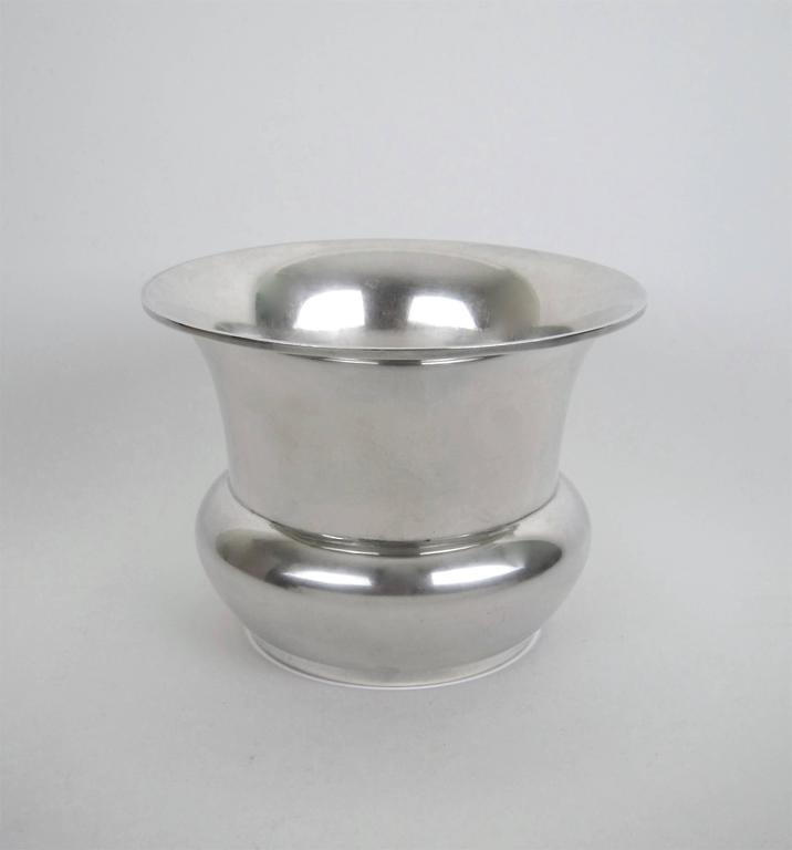 An American sterling silver vase with a flaring, wire-wrapped rim by Marie Zimmermann (1879-1972), a noted metalsmith, jeweler and designer active during the opening decades of the 20th century. The vase comes from Zimmermann's estate and dates