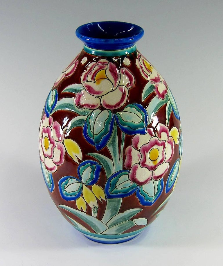 A large Art Deco vase produced at Boch Freres Keramis, Charles Catteau's l'Atelier de Fantaisie art pottery workshop at La Louvière, Belgium, circa 1932. Boch Freres produced a notable range of bold and colorful ceramics during the Art Deco period,