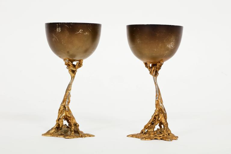 Gabriella Crespi Signed Brass Chalices 1970 Mid Century Italian  Dimensions: 3.5 in diameter, 7 in height, base 3 in.  About Gabriella Crespi (Designer) Bronze discs that open up like clamshells for storage and fold back in to become side