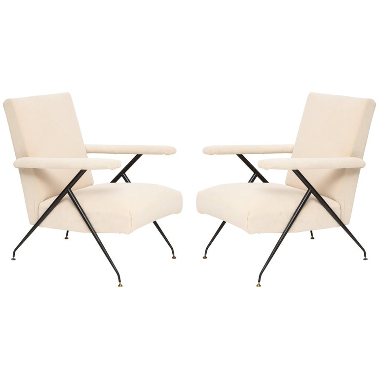 Enameled pair of white metal leg reclining chairs, Italy, 1950s.  Beautiful white with a pink undertone velvet pair of chairs with enameled metal legs and brass feet. These chairs recline back. They are comfortable and architecturally stunning.