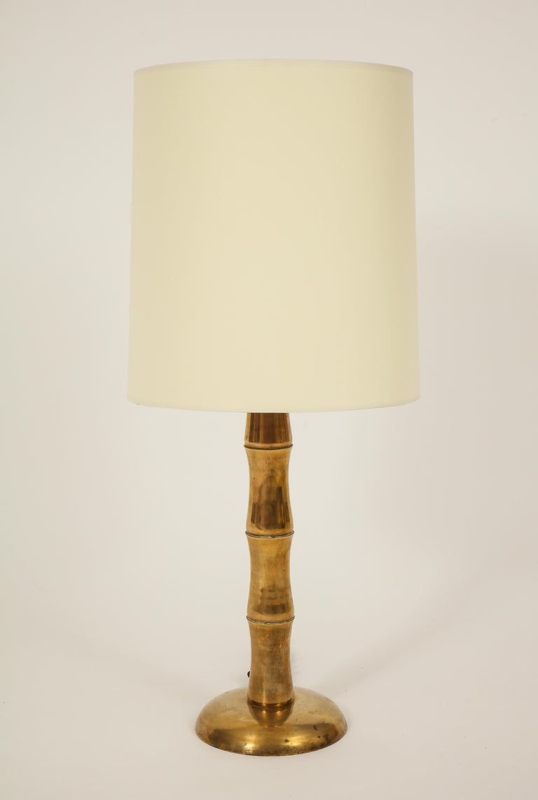 Jansen style bamboo brass French midcentury pair of table lamps.  Beautiful pair of brass lamps with perfect patina to the brass as shown in photos. The perfect height and look to any decor. Rewired for US. Silk Black cord attachment. Shades not