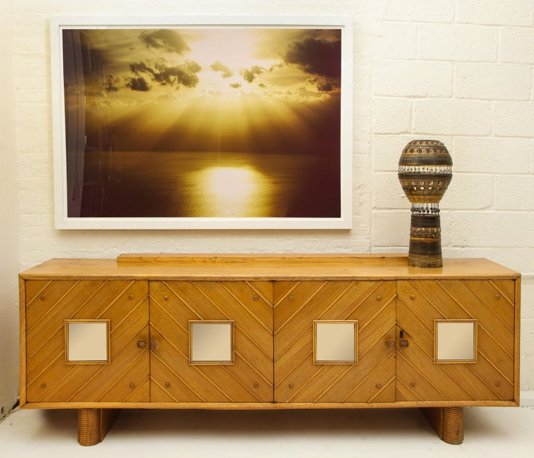 Pier luigi Colli oak sideboard, Mid-Century Modern Italy, 1950s  Beautiful oak sideboard. The oak has lovely patina throughout the piece.  It is a large-scale sideboard with four doors and architectural details throughout. Amazing oak grain visible