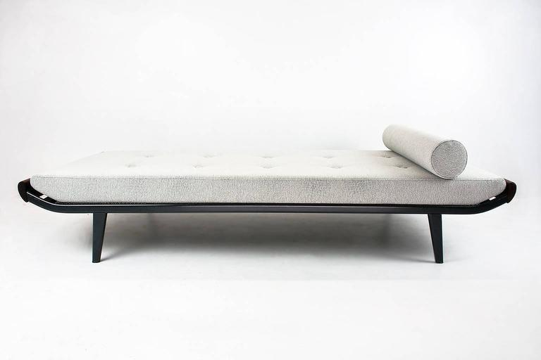 New upholstered Cleopatra daybed designed in 1953 by Dick Cordemeijer for Auping (Holland). The frame is made of dark grey coated metal and the ends are in solid teakwood. The springs are in excellent condition. This piece is upholstered in a good