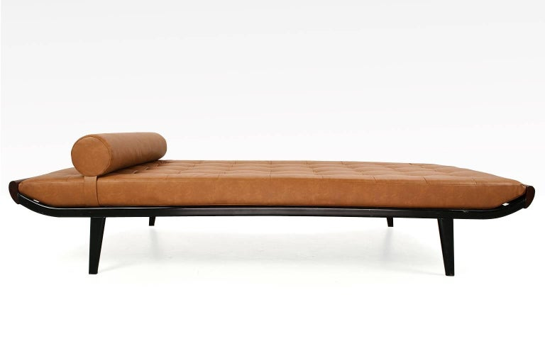 Mid-Century Modern Dutch daybed new upholstered in an excellent quality brown or cognac coloured faux leather padded upholstery, on new double layered foam fillings. The springs are in excellent condition. This piece is re-upholstered with